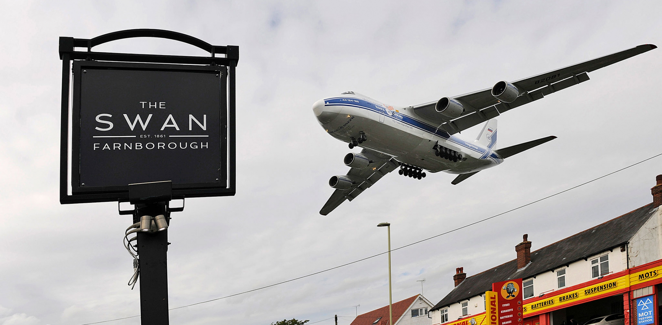 airplane flying over pub