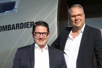 Bombardier president and CEO Eric Martel and senior v-p of sales Peter Likoray celebrate the early sales successes for the new super-midsize Challenger 3500. Barry Ambrose